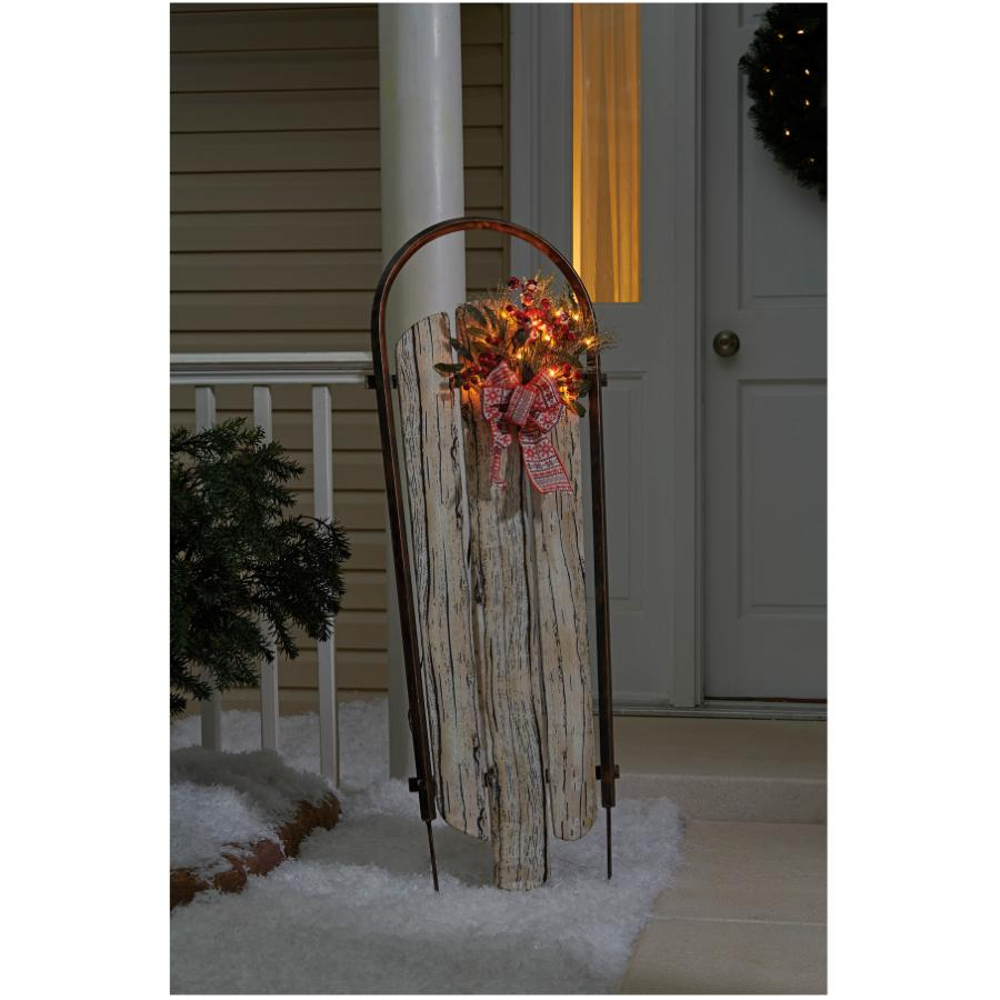 """Sylvania 48"""" Faux Wood Sleigh with Bow & Garland, with Lights"""
